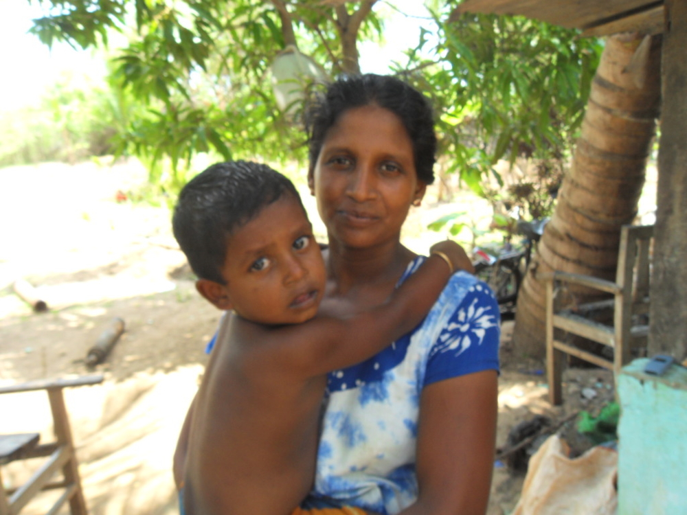 "Nalini Vijayarani, 36, resettled in Kilinochchi on December says "" Ourconditions are extremely hard. Its been four months till we resettledbut we are still struggling with housing"""