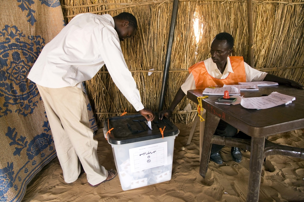 A voter in a polling station in Zam Zam IDP Camp, El Fasher (North Darfur)