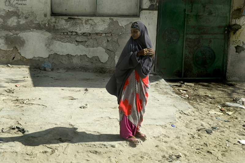 A woman walks through a street on April 4, 2010 in the capital Mogadishu. Over the years hundreds of thousands of Somalis have fled to neighbouring countries. More than one million people, in a nation the UN estimates to be nine million, are internally di