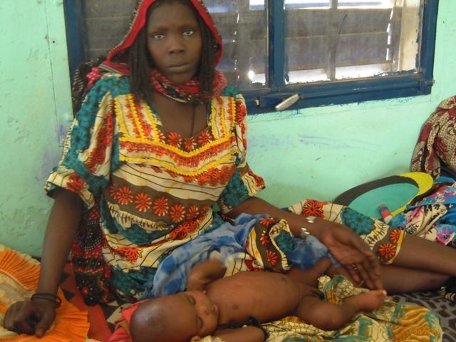 Mother and child at therapeutic nutrition feeding centre in Mao, western Chad's Kanem region
