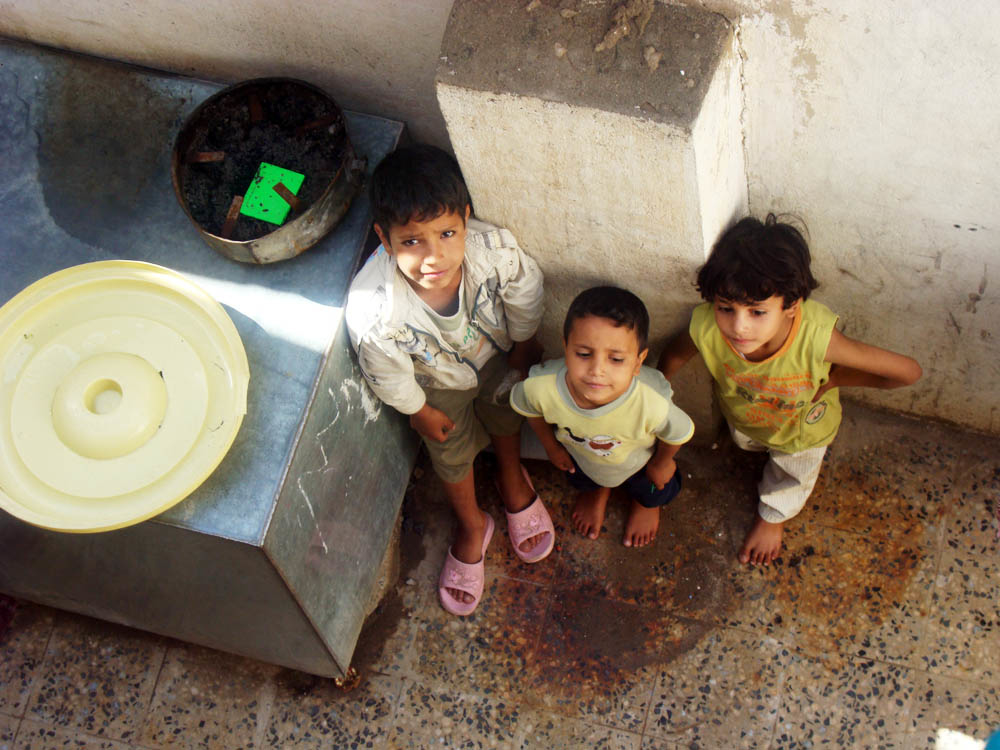 Unclean water storage tanks in slums have been blamed for the spread of the dengue-carrying mosquito
