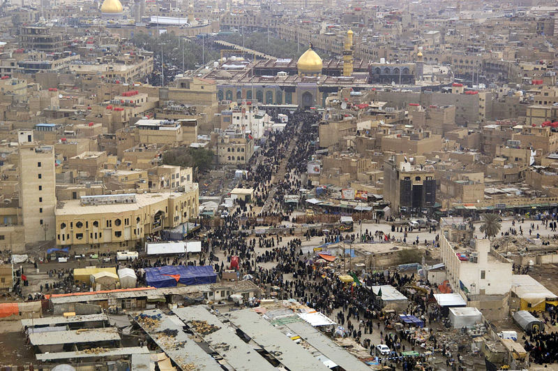 Shia Muslims make their way to the Imam Hussein Shrine in Karbala, Iraq