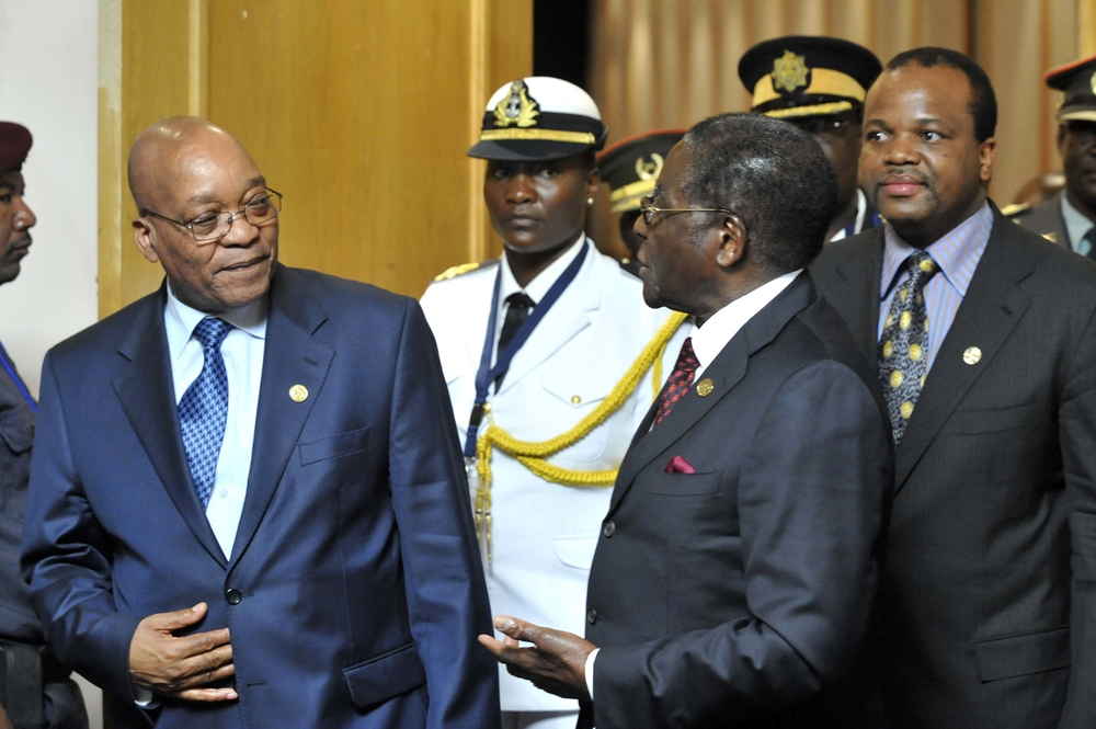 President Jacob Zuma with Zimbabwe President Robert Mugabe as they come out of the closed session of the SADC Summit for Heads of State and Government which began on 16 August in Windhoek, Namibia. In the background is Swaziland King Mswati III