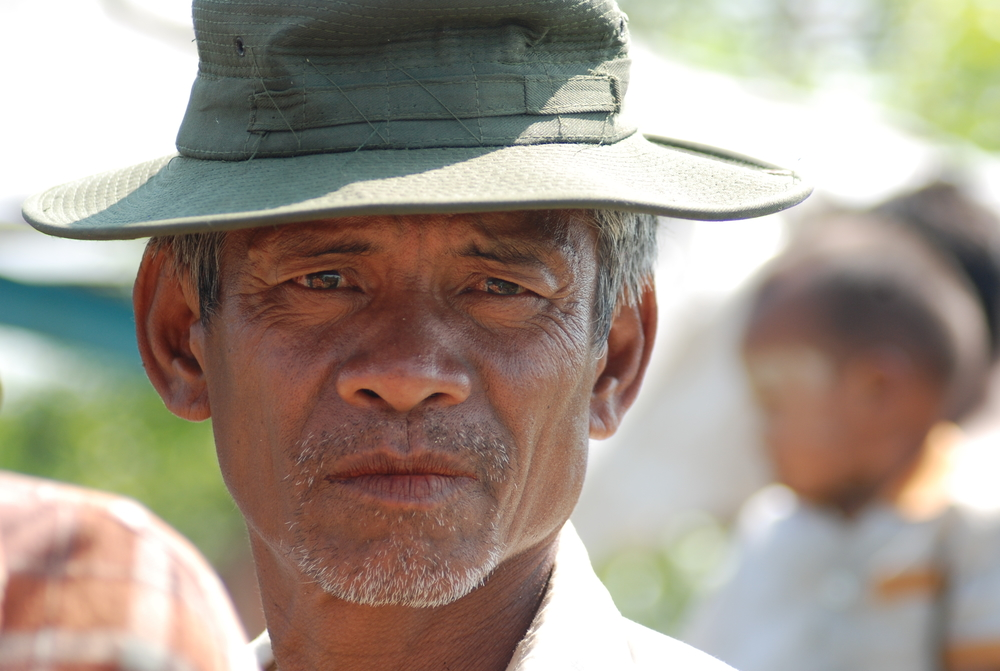 A man looks to the camera in Myanmar's Ayeyarwady Delta