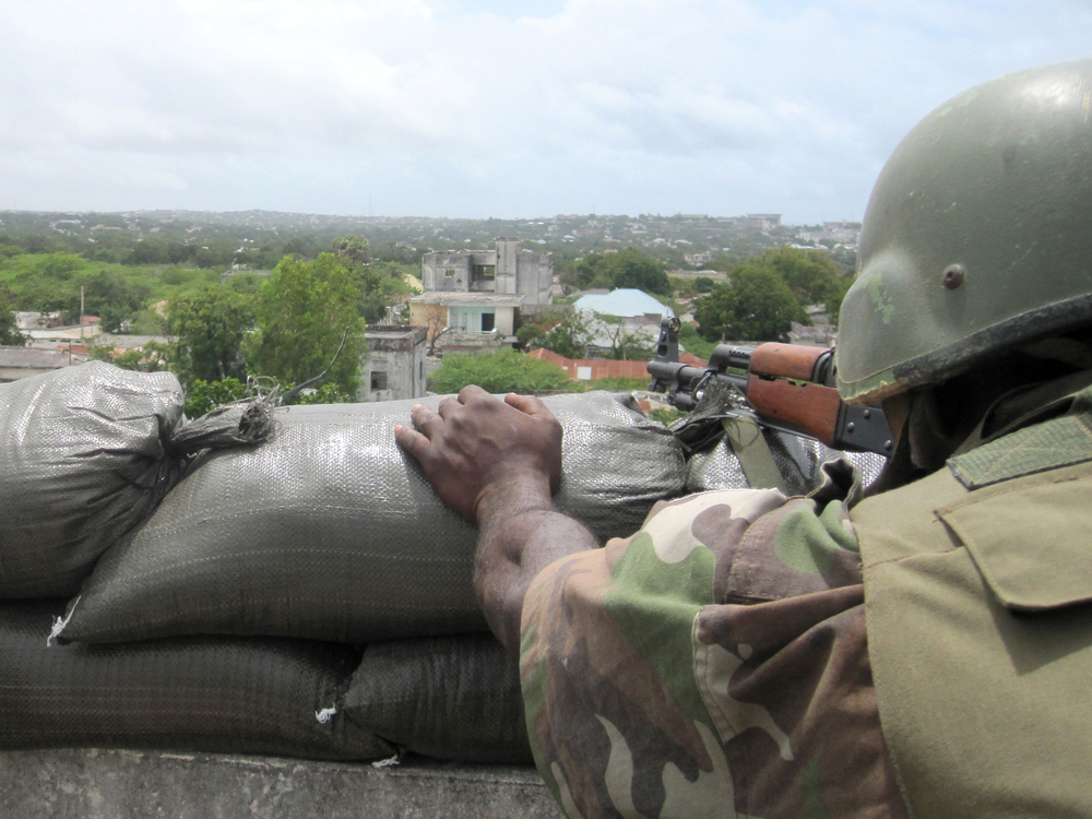 An AMISOM soldier prepares to engage an al Shabab sniper position
