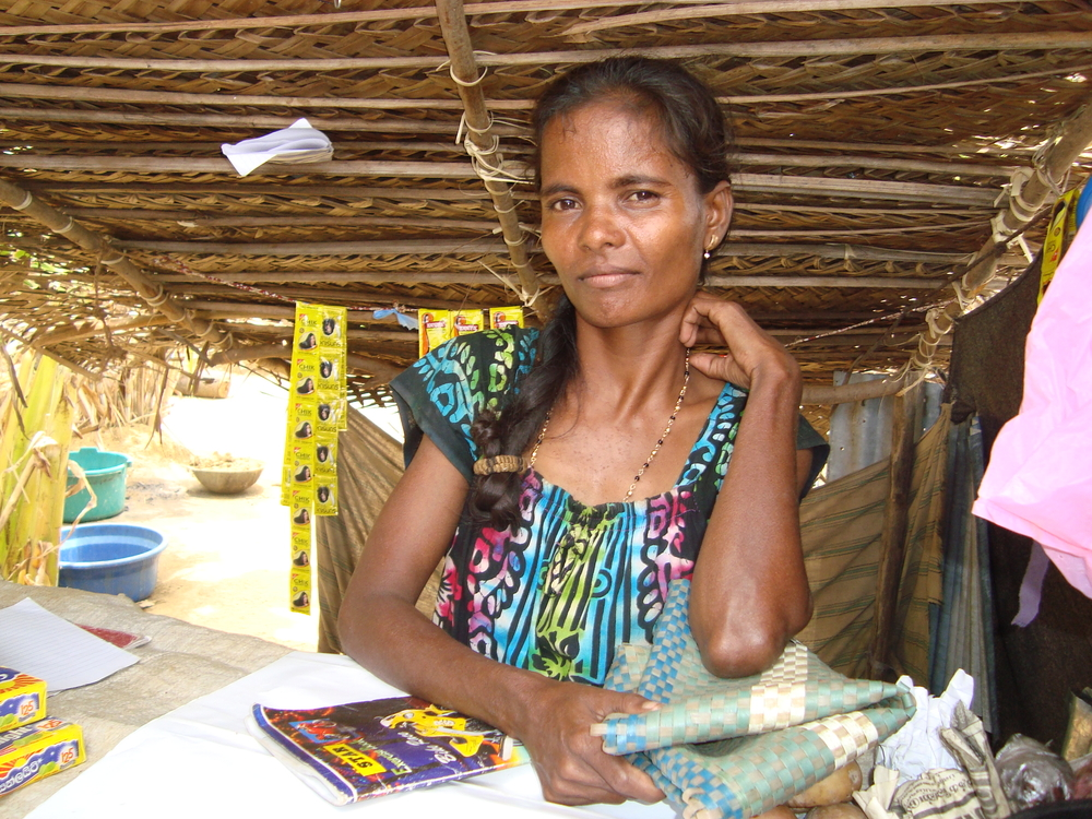 Kaliamagal, the owner of a small shop at a camp for the displaced in northern Sri Lanka. Many women are now their breadwinners of their families