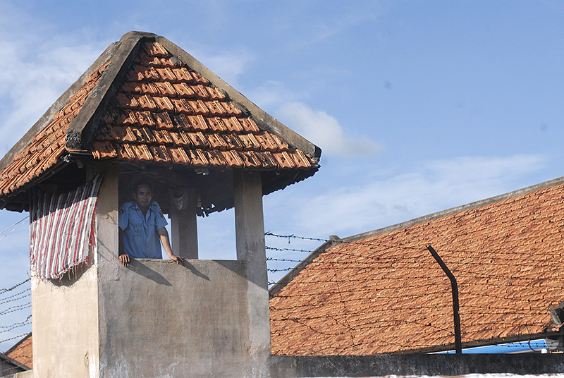 A guard stands watch from a old prison in Pursat Province in Cambodia