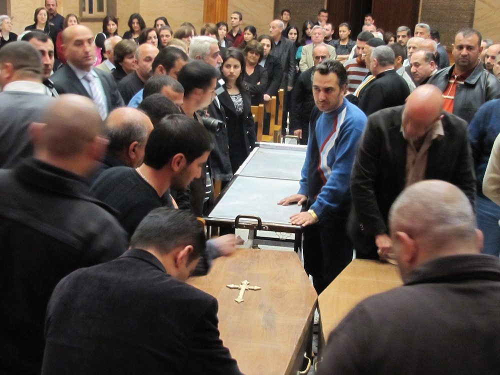 Mourners at an Ankawa funeral of a Christian couple killed by extremists in Baghdad