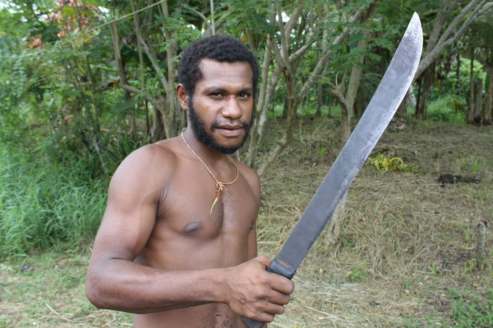 A tribesman with a traditional sharpened bush knife in Madang Province