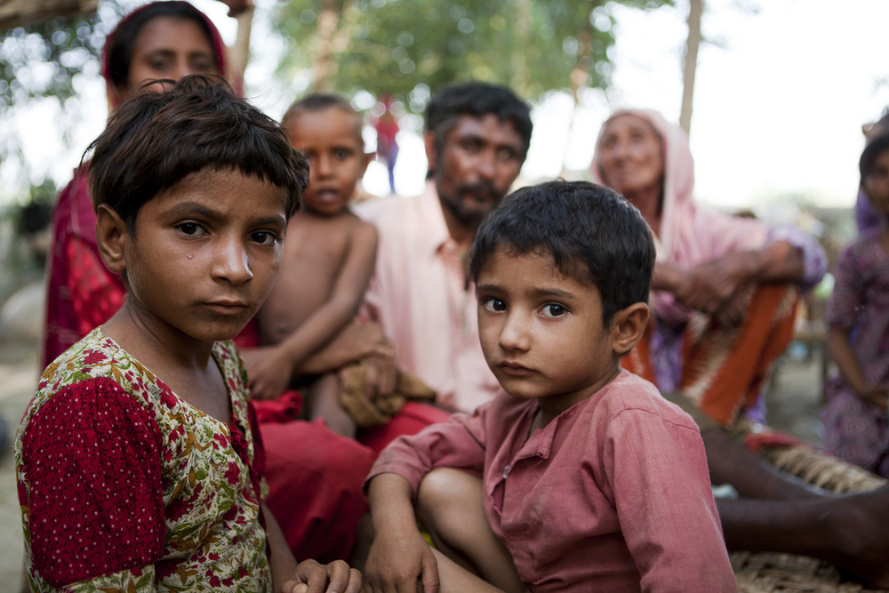 A family at a makeshift camp for persons displaced by the extensive flooding in the district of Muzzafargarh