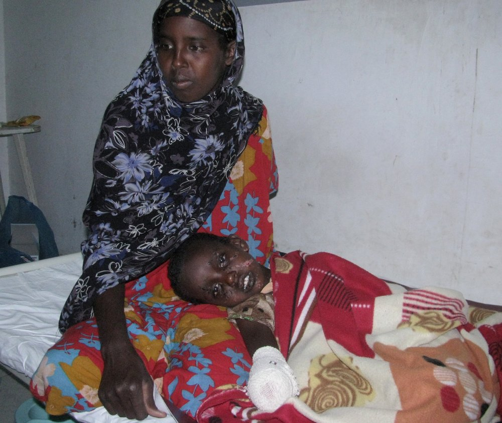 Saida Mohamed with her child, Habon Ahmed, who was injured in a landmine explosion in Somaliland