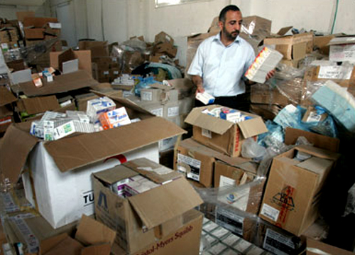 Officials from the Gaza health ministry sorting drugs and medical supplies donated to Gaza. Donated drugs are often expired or are not according to the needs, reports the World Health Organization (WHO) in Gaza