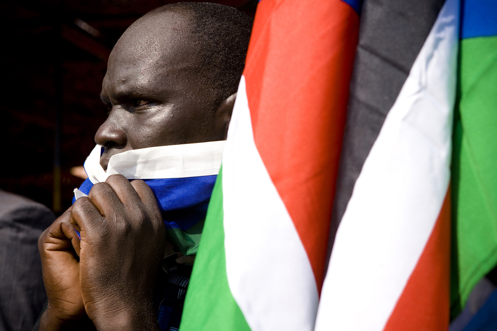 A man reacts as the preliminary results of the referendum are announced in Juba on January 30, 2011