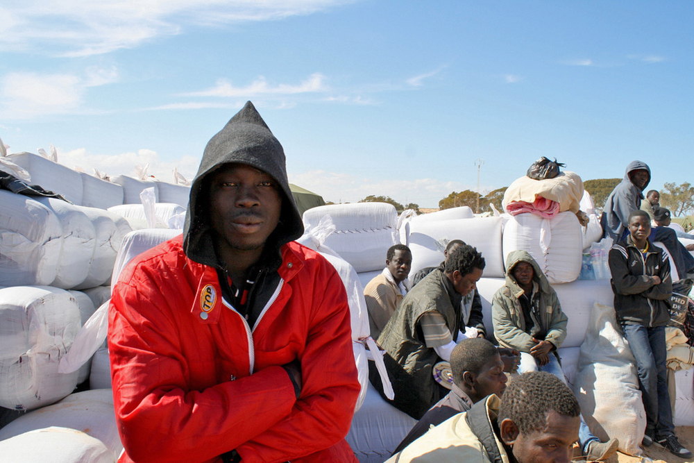Patrick Yaw, a migrant worker from Kumasi in Ghana at the Libya-Tunisia border