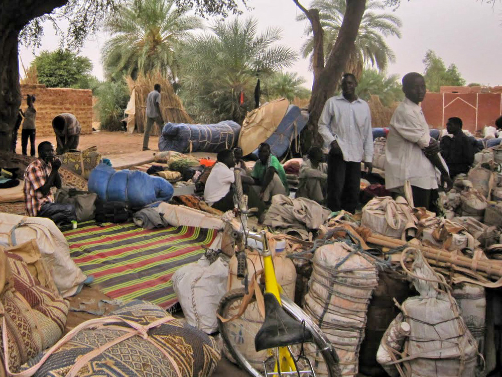 West African migrants with their belongings in Dirkou, northern Niger. The village has long been on the migrants' route from West Africa to Libya; now people are headed the other way. March 2011