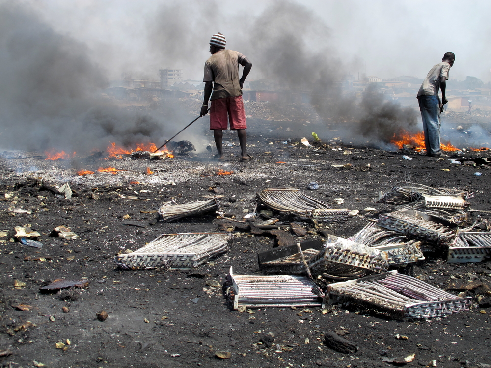 Youths in the Ghana capital Accra burn insulating foam from discarded refrigerators