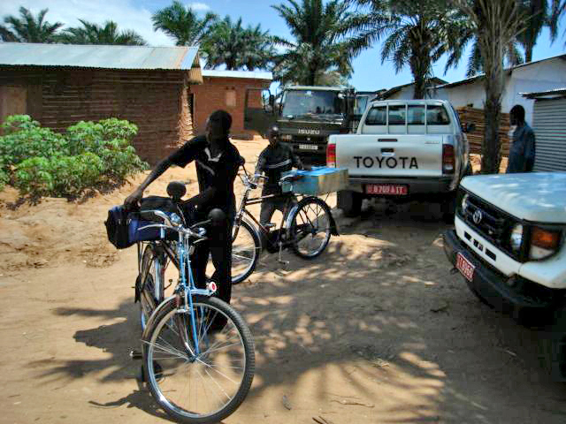 Two former child soldiers in Rumonge commune receive bicycles under the DDR programme