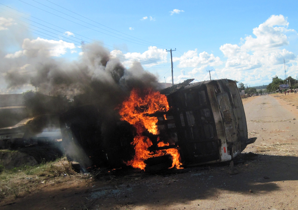 A bus burns after being set ablaze by rioters in Mansa, northern Zambia
