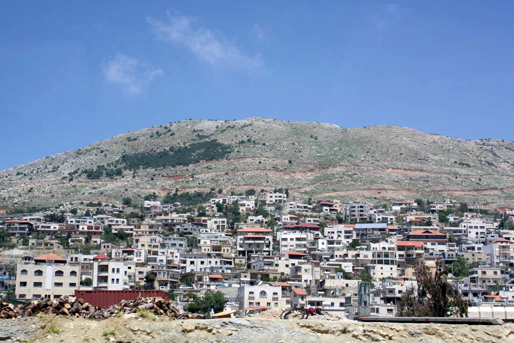 The Druze village of Majdal Shams in Israeli-occupied Golan is separated by a mountain range from Syria