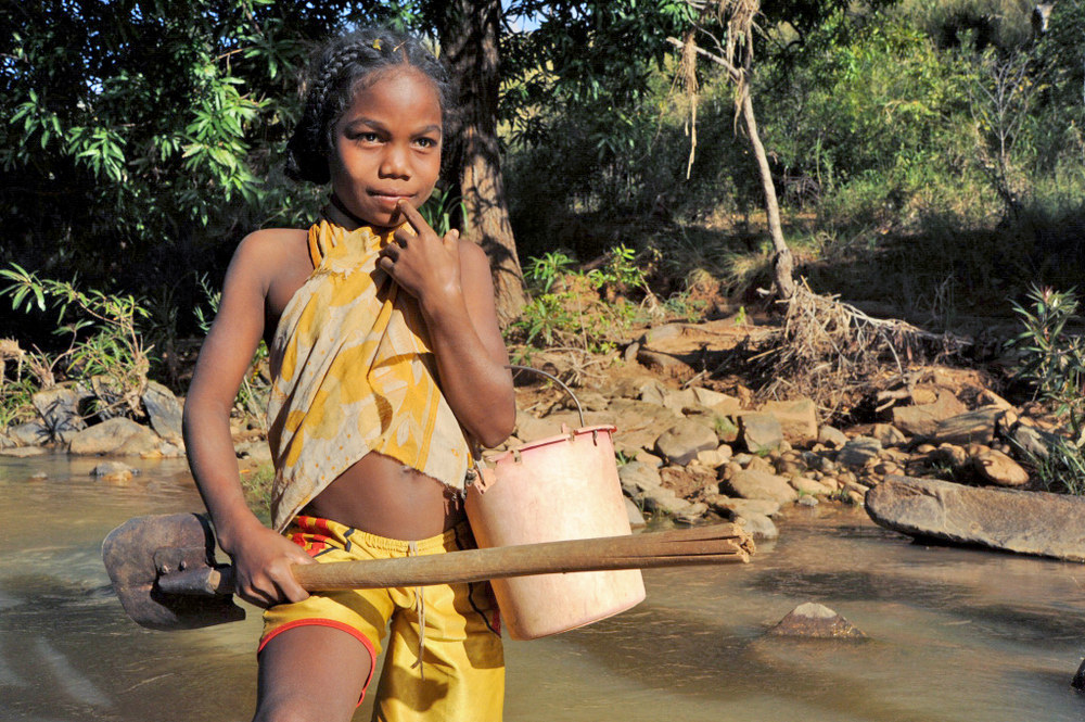 A young Madagascan girl prospecting for gold in Madagascar