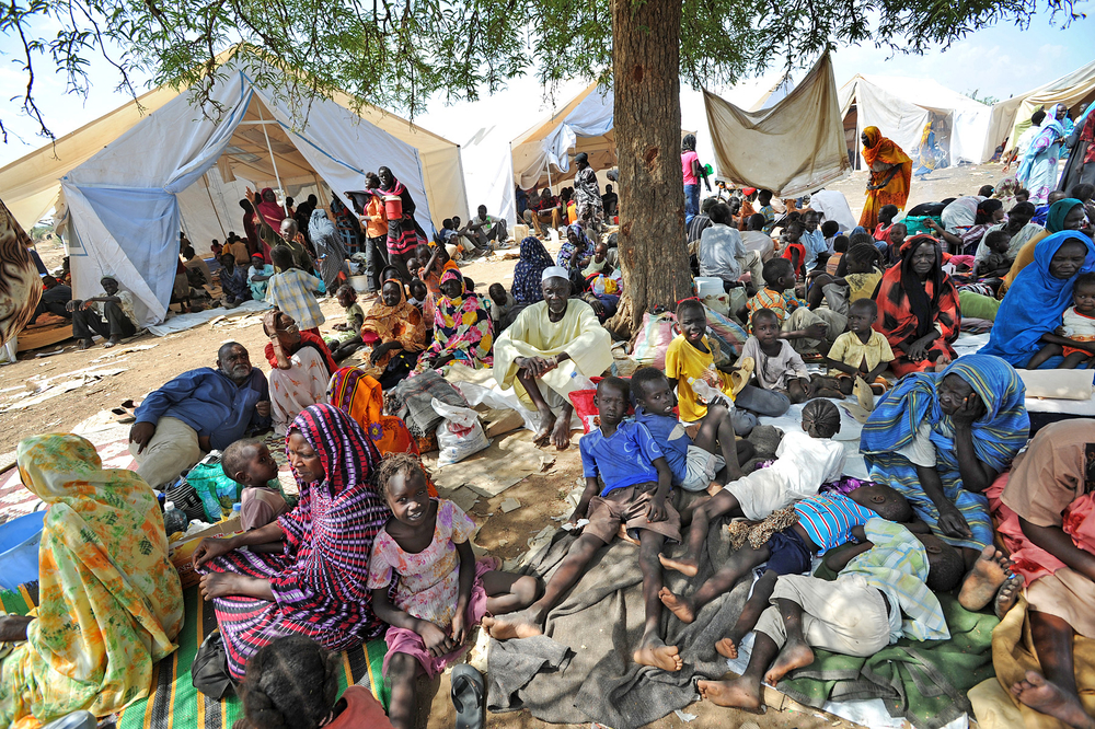 Residents of Kadugli gathered outside UNMIS sector HQ after fleeing fighting in Kadugli town