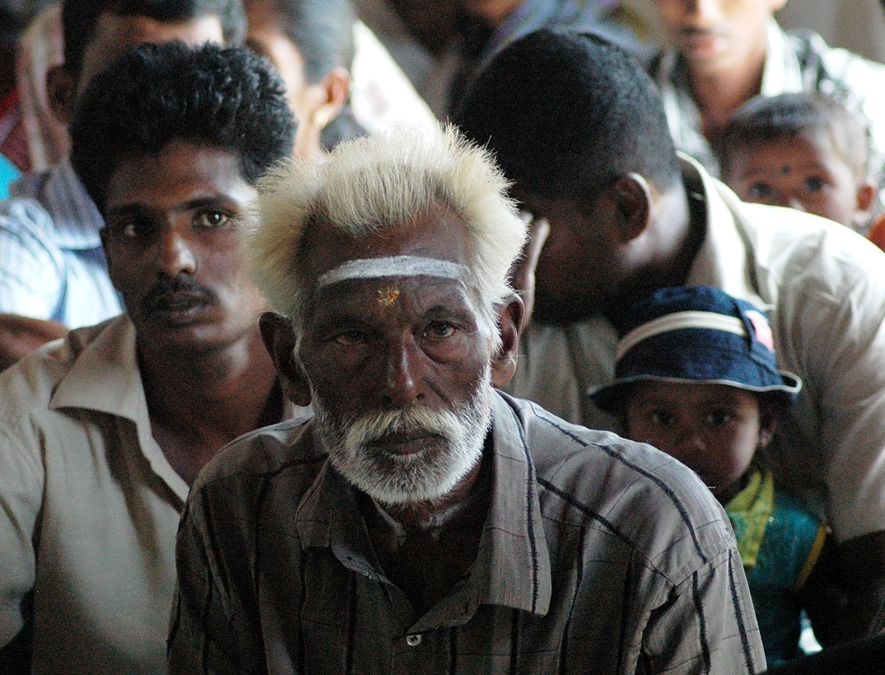 An old man attends a community meeting in the village of Thunukkai in the Mullaittivu District. Thousands of displaced have returned to Sri Lanka's former war zone