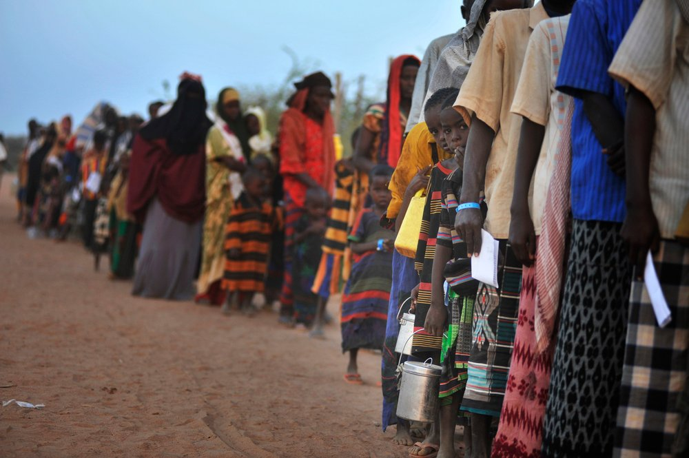 Newly arrived refugees wait to be processed at Dadaab refugee camp, northern Kenya. For generic use