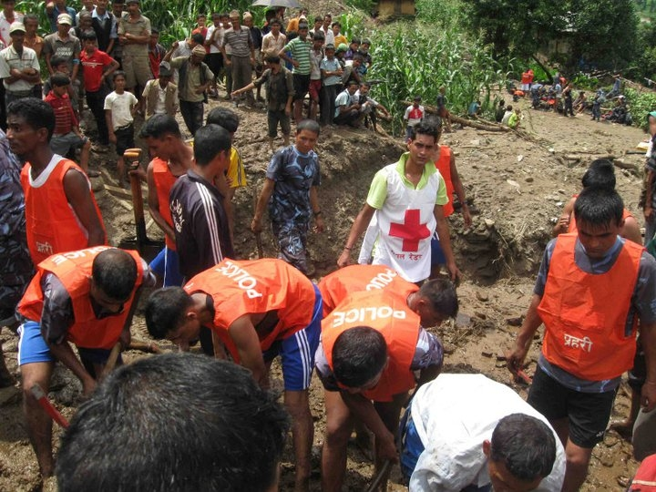 Rescue worker on the scene of a landslide in July 2011. Incessant rains have resulted in landslides across parts of Nepal