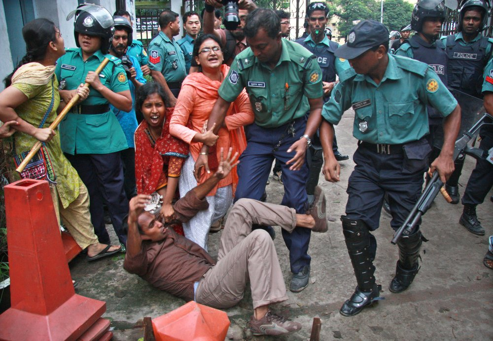 An activist is manhandled during a protest in July 2011 in Dhaka. Bangladeshi police have often been accused of heavy-handed tactics