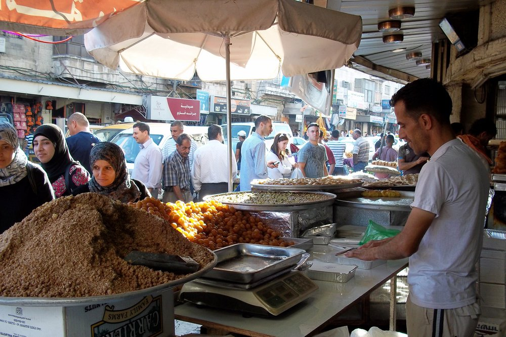 Palestinians buying traditional Ramadan sweets in Ramallah before 'iftar' (daily meal breaking the fast)