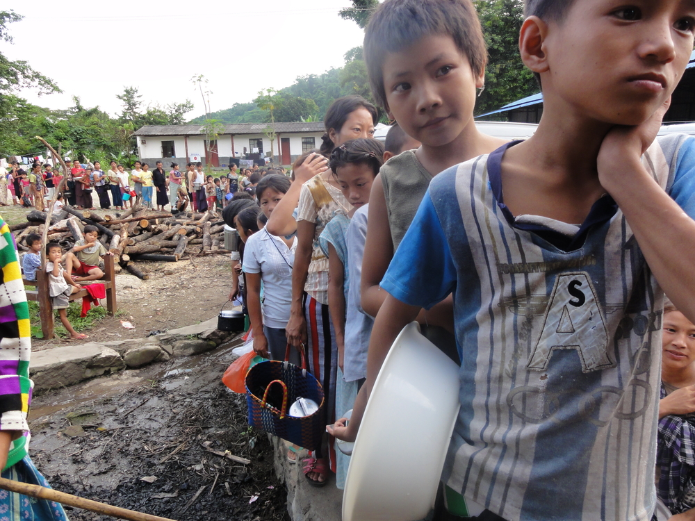 Kachin IDPs line up for food rations along the Burmese-Chinese border. The area has witnessed an upsurge in fighting between government forces and the Kachin Independence Army (KIA)