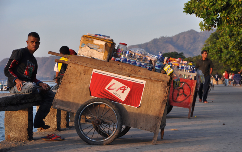 A young man sells refreshments on the waterfront in Dili. Unemployment remains high in the capital