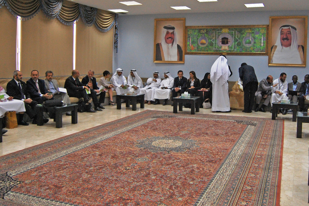 Aid workers and donors from the Arab and Muslim world mingle with members of the UN and other aid agencies at an information sharing meeting in Kuwait in September 2011