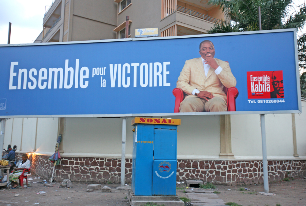 The DRC's ruling coalition of President Joseph Kabila had started putting up banners and posters in the capital, Kinshasa, long before the official start of election campaigns on 28 October