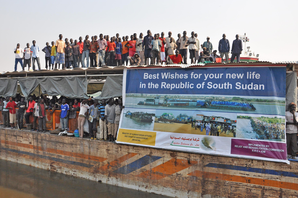 A barge arrives in the South Sudanese capital, Juba, carrying hundreds of people from Sudan. People of southern origin living in Sudan lost their citizenship after the South gained independence in July 2011