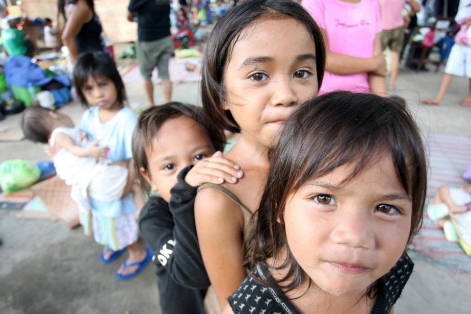 A group of children displaced by floods living in an evacuation center in Iligan City. Tropical storm Washi claimed more than 1,000 lives as flash floods and landslides hit rural communities on 17 and 18 December 2011