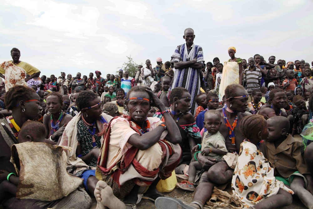 People displaced by clashes in South Sudan's Jonglei state wait for a food distribution in Pibor