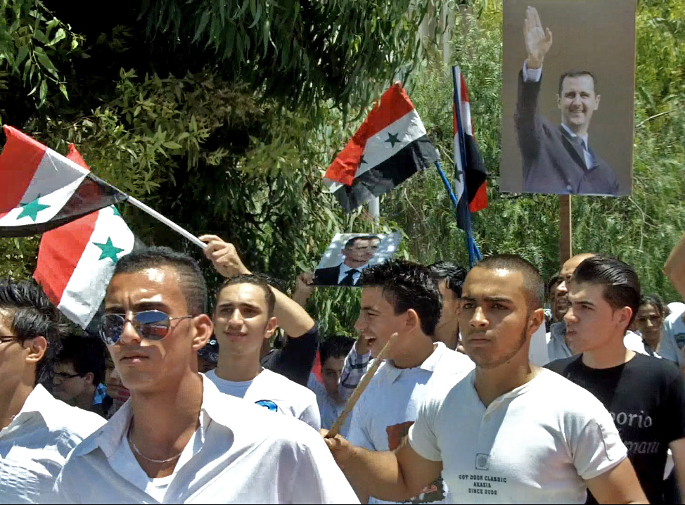 A demonstration in support of Bashar al-Assad in autostrad Mezzeh, Damascus on 15 June 2011