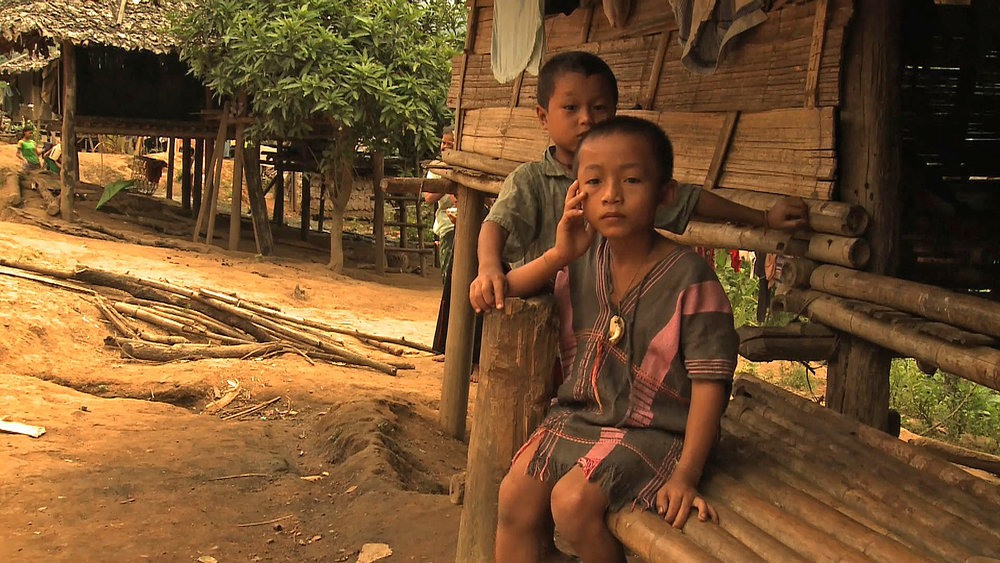 Two children look to the camera at a Karen IDP camp along the Salween River. Thousands remain displaced in eastern Myanmar due to conflict
