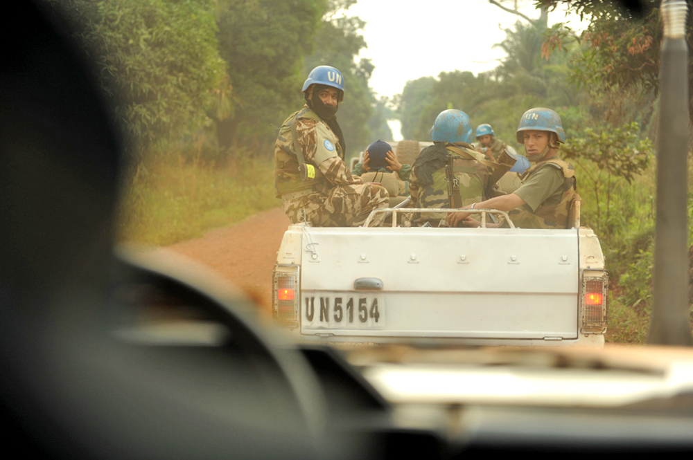Troops of the UN Stabilization Mission in the DRC (MONUSCO) providing an armed escort on the road from Dungu to Faradje