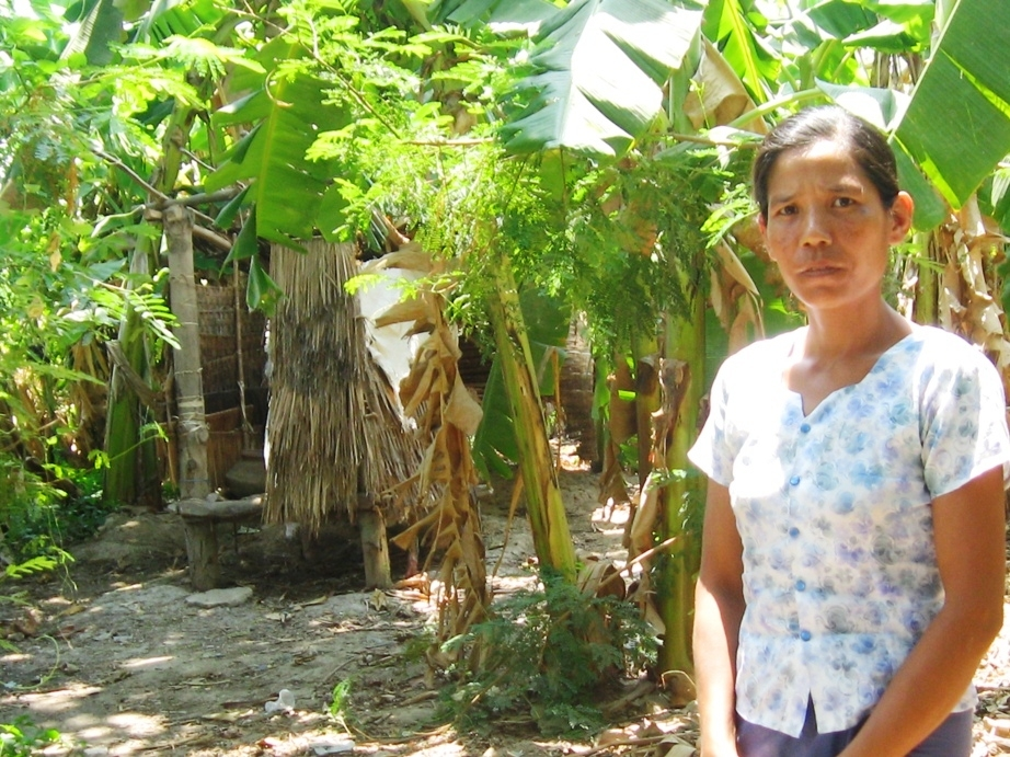 A woman in front of her newly built latrine in Myanmar's west Bago Division