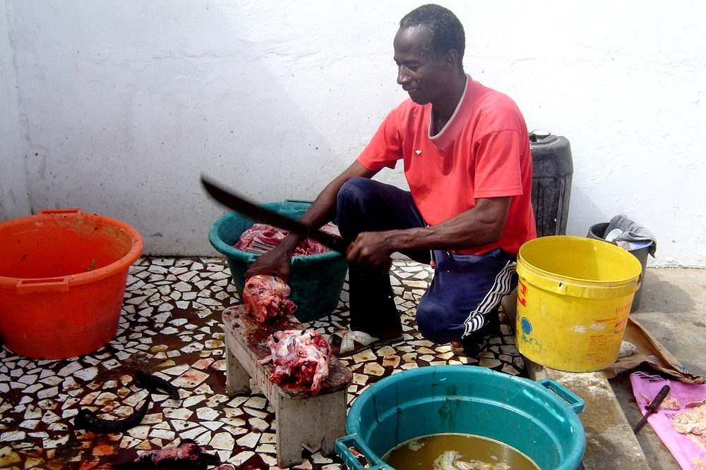 A man chops up an animal that has been slaughtered for the Muslim Eid al-Adha holiday in Dakar, Senegal in 2007. Normally, such meat is distributed to the poor, and the rest of the body thrown away, but Muslims are increasingly finding innovative ways to