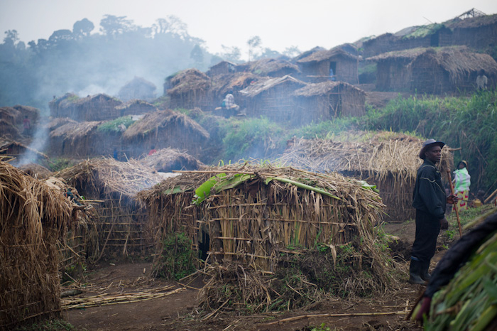 A displaced Congolese man stands amongst homes built in a camp for the internally displaced in Katoyi in Masisi territory in the Democratic Republic of the Congo's North Kivu on June 4, 2012