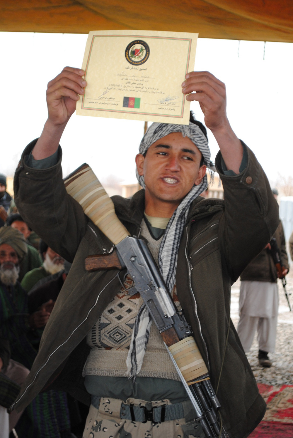 Afghan Local Police (ALP) graduates hold up certificates in Imam Saheb, the second district in Kunduz to undergo ALP training. Post-NATO withdrawal ALP and other militia are becoming increasingly abusive