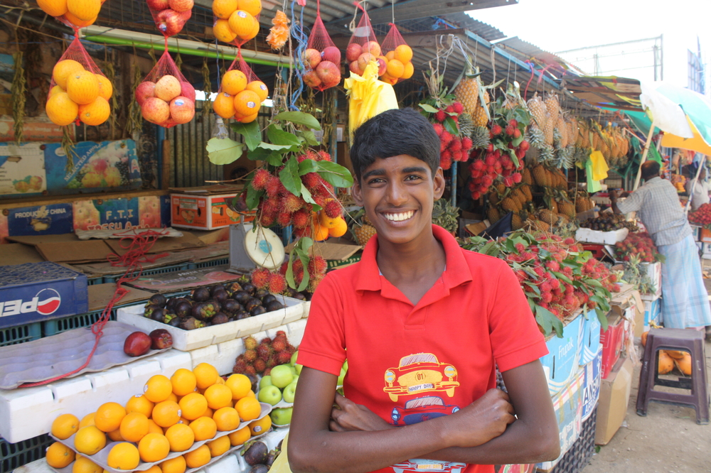 A young street vender in Jaffna. Despite high levels of food insecurity, fruit and vegetables are plentiful in the city