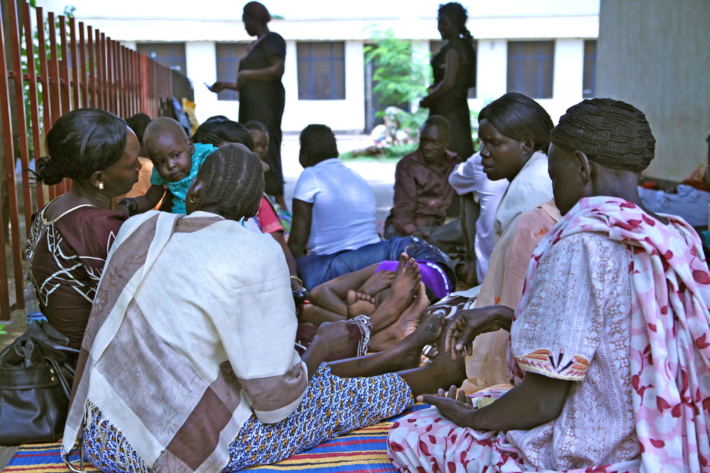 Women wait outside Juba Teaching Hospital's cramped maternity ward