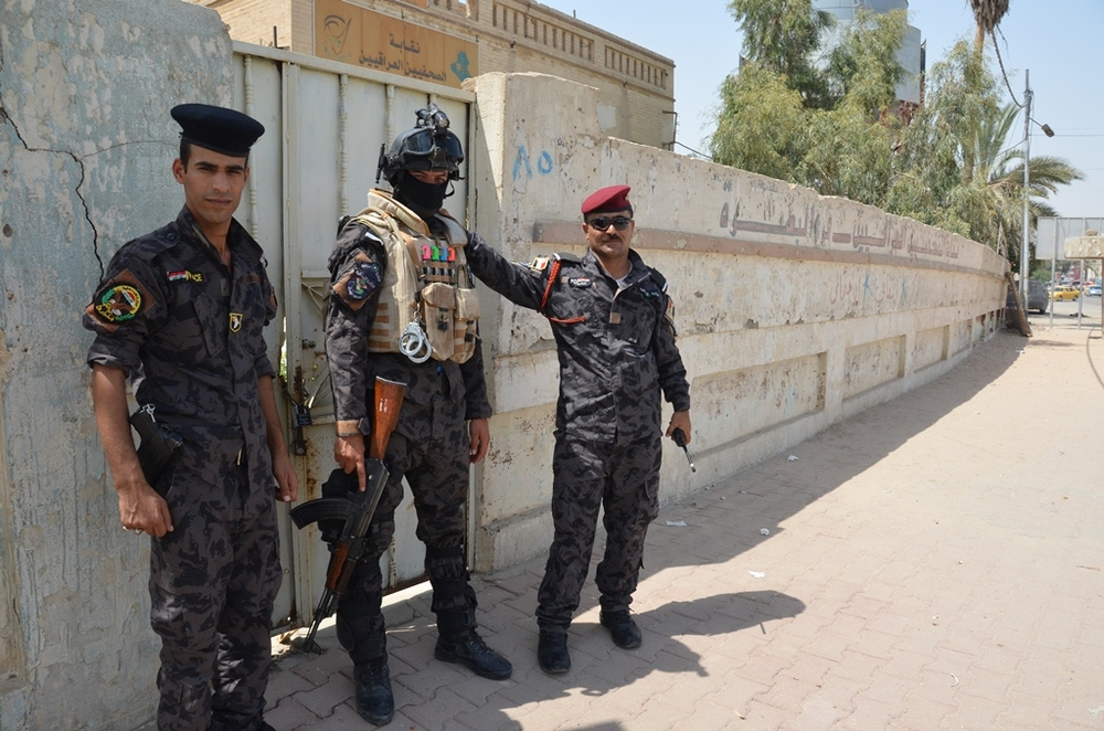 Members of Iraq's SWAT police - tasked with escorting UN staff as they travel - stand guard during a UN meeting at an office in Basra, southern Iraq in July 2012