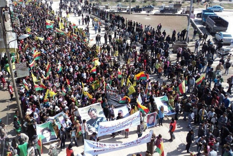 Supporters of the Democratic Union Party (PYD) - the Syrian offshoot of the PKK - hold a rally in the northeastern Kurdish Syrian city of Kobani, carrying portraits of Abdullah Öcalan, the founder of the PKK. Kurds that were once silent in the Syrian upr