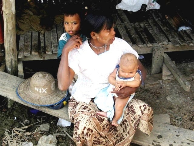 A mother and her two children in Myanmar's Ayeyarwady Delta