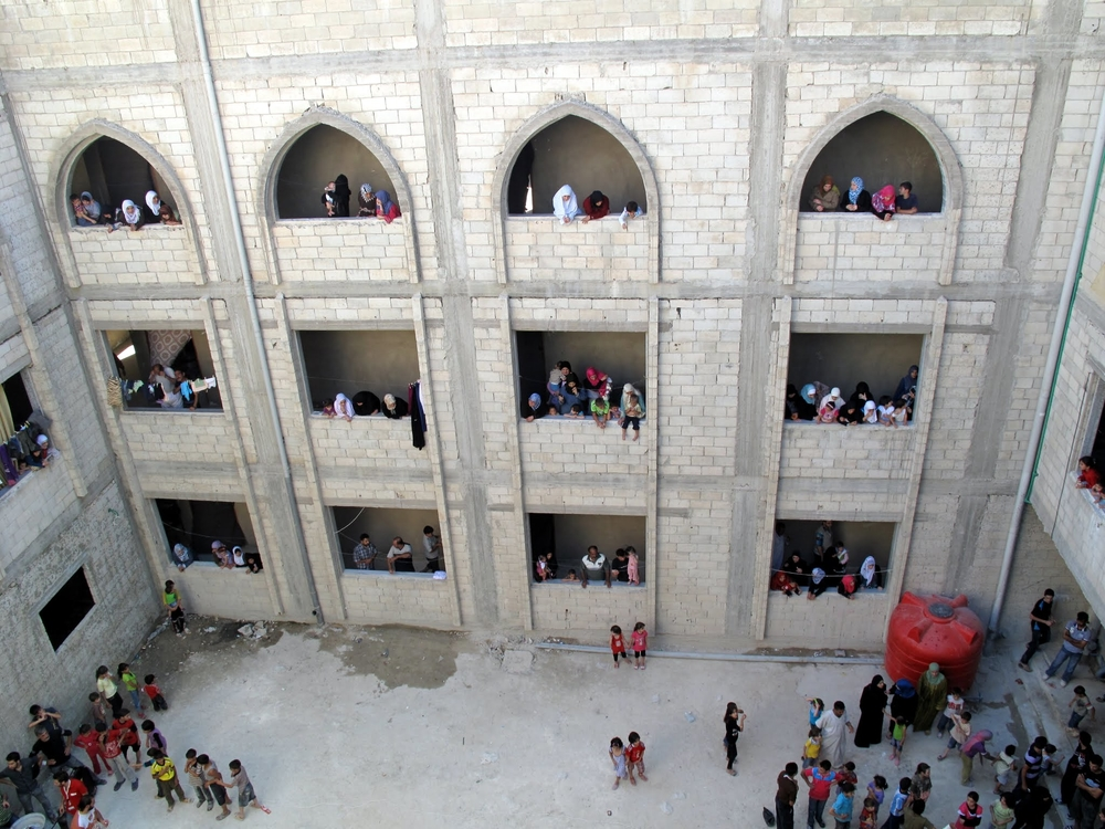 People displaced by the Syrian conflict are housed in schools and public buildings, like training institute, still under construction in Homs.